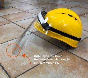 Helm-Gesichtsschutz bitte nicht am Visier ablegen!